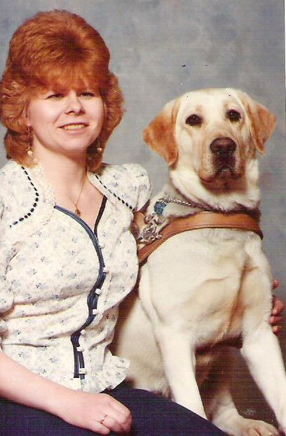 Karen Ann with first guide dog Audrey, a yellow Lab.