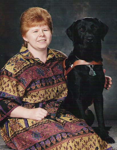 "Karen Ann & Merlin  I met my big boy Merlin at GEB in August 1991.  He was known as ""Mr Perosnality"" by all who knew and loved him.  Merlin was a very large black Lab who took his job as my guide very seriously, yet was about the silliest fella I've ever know.  He had a huge heart and a huge smile, and he flashed that smile and showd his heart to everyone.  I miss my sweet big bubba boy.  He passed away Nov. 20, 1998 of a rare throat cancer.  He was 9 yrs old."
